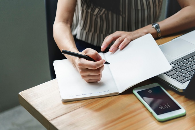woman writing on a business plan