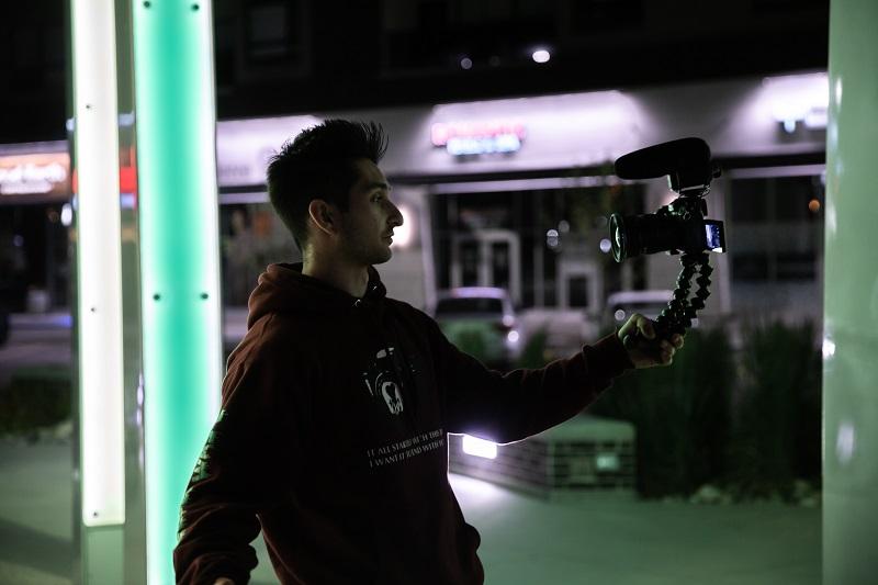 man holding a vlogging camera